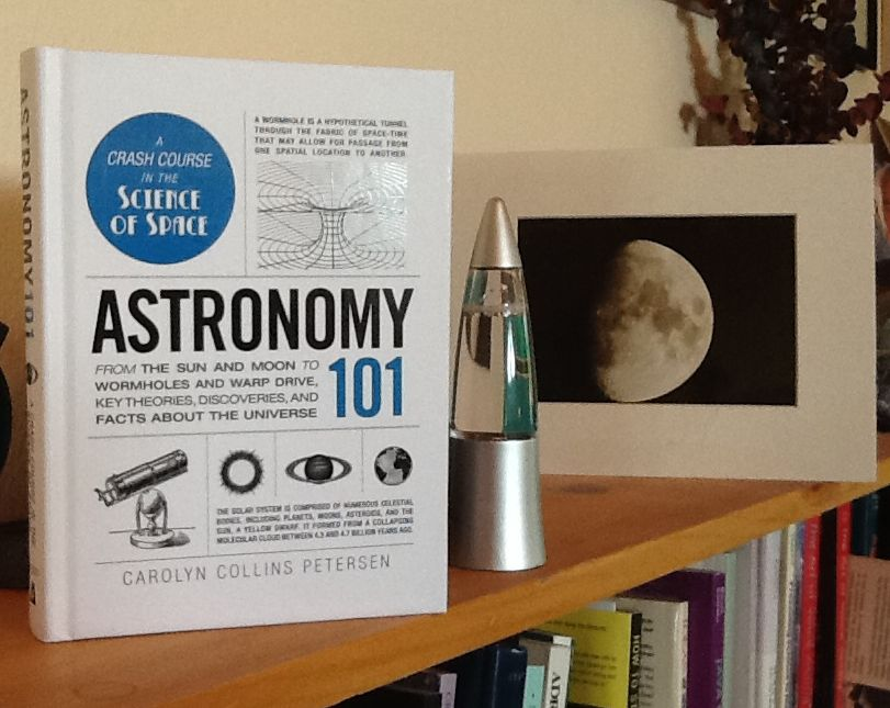 Astronomy 101 on my bookshelf.