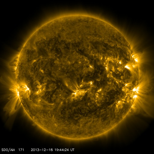 A Dec. 8 image of the Sun from the Solar Dynamics Observatory, showing regional magnetic field lines and plasma flowing along them in active regions. Courtesy SDO/NASA.